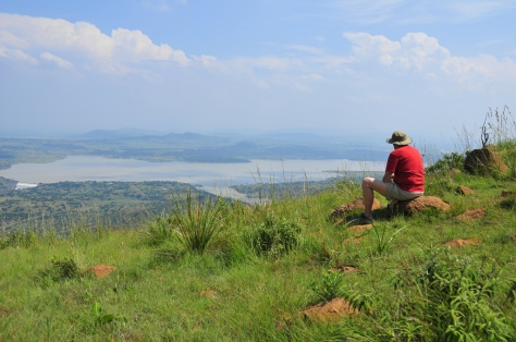 John contemplating the battle - an overflowing Spioenkop dam far below