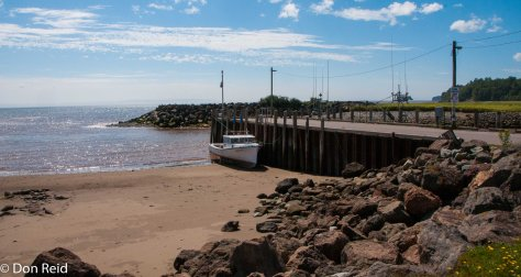 The beach and small harbour at Alma - the tide gets the boat back up to the jetty