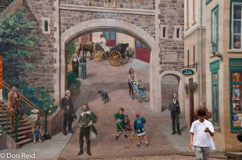 Wall art blends with reality (clue : the guy with the cellphone) in the Old Town, Quebec City