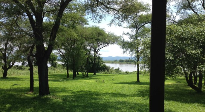 The gardens at Rademan's Farm, Zambezi River in the distance