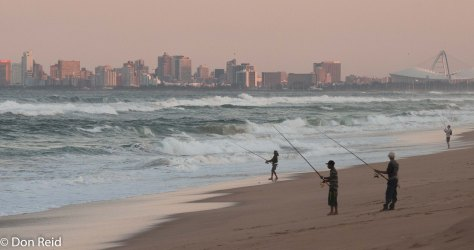 Fishermen on La Lucia beach, Durban in the background