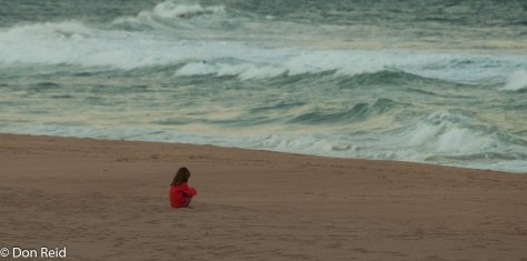 Lonely girl on La Lucia beach