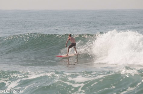 A surfer off La Lucia beach