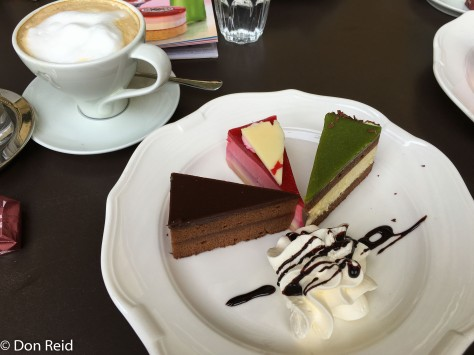 Trio of cakes and a Wiener Melange coffee